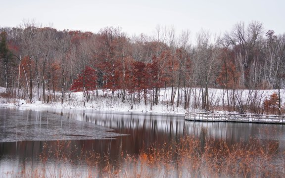 Reflections on a lake after a snow fall