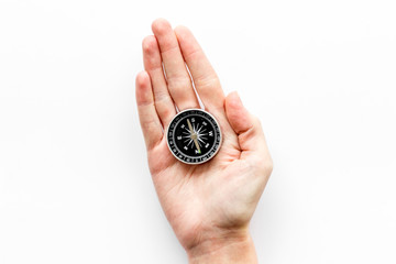 Choose direction concept. Compass in hand on white background top view copy space