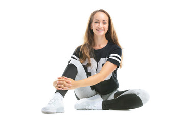 Closeup portrait of happy caucasian woman practicing fitness and smiling isolated at white background.