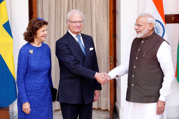 Sweden's King Carl XVI Gustaf shakes hands with India's PM Modi as Queen Silvia looks on during a photo opportunity ahead of their meeting at Hyderabad House in New Delhi