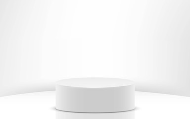 white cylinder in the white studio room