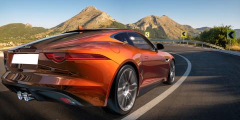 Jaguar F-Type on a winding mountain road