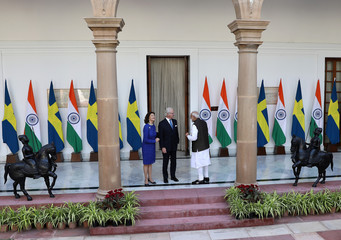 Sweden's King Carl XVI Gustaf speaks with India's PM Modi as Queen Silvia looks on during a photo opportunity ahead of their meeting at Hyderabad House in New Delhi