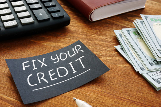 Writing note shows the text Fix your credit
