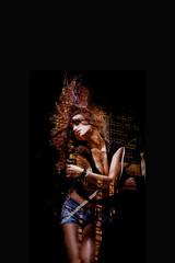attractive woman dancing double exposure on dark background