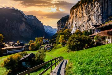Fotobehang Alpen Famous Lauterbrunnen valley with gorgeous waterfall and Swiss Alps, Switzerland.