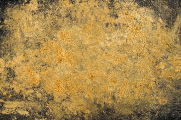 Unique handmade wall texture of golden yellow on dark color
