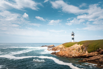 Lonely lighthouse on the coast of Galicia, Spain. Island of Pancha near Ribadeo
