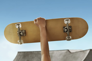 Man holding skateboard at skatepark