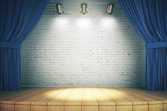 Wooden stage with blue curtains