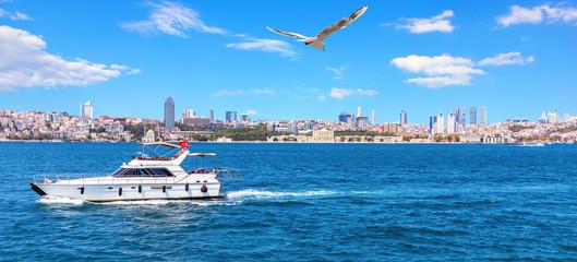 Yacht in the Bosporus and Besiktas view, Istanbul