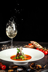 Spanish food concept. Gazpacho tomato soup with seafood, mussels and white wine. Background image.  copy space