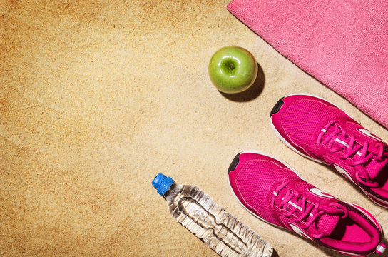 Top view beach and fitness accessories. Background with copy space