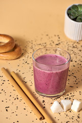 Pink berry smoothie with bamboo straw