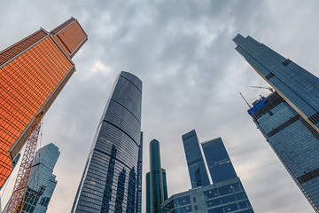Tops of modern corporate buildings against the gloomy sky. high-rise buildings and skyscrapers Moscow International Business Center (Moscow City), Russia. City view from the bottom up