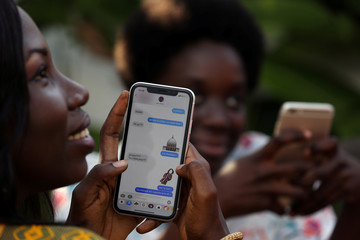 A woman uses Zouzoukwa emojis during a chat with friends in Abidjan