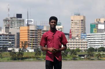 O'Plerou Grebet, creator of Zouzoukwa emojis, poses for a photograph in Abidjan