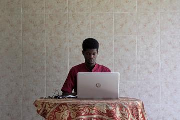 O'Plerou Grebet, creator of Zouzoukwa emojis, works at his home in Abidjan