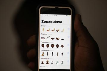 Mobile phone screen displays Zouzoukwa emojis in Abidjan