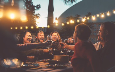 Happy family dining and tasting red wine glasses in barbecue dinner party - People with different...