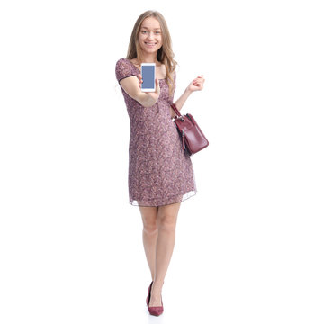 Woman in dress and high heels with red bag smiling walking goes, showing mobile phone, space for text on white background isolation