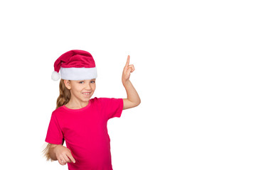 Child girl in santa hat smile and point something up.