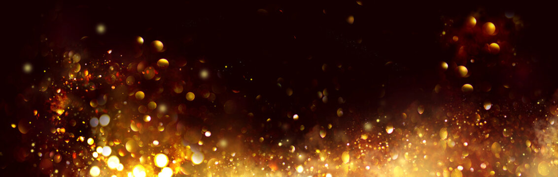 Golden Christmas and New Year glittering stars swirl on black bokeh background, backdrop with sparkling golden stars, holiday garland, magic glowing dust, lights. Gold Abstract Glitter Blinking sparks