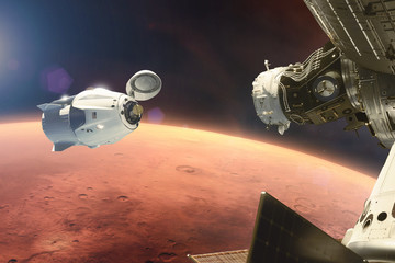 Spoed Foto op Canvas Heelal Cargo spacecraft in low-Mars orbit. Elements of this image furnished by NASA.