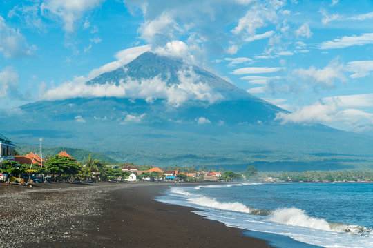Morning sunny view on Agung volcano from the coast in Amed, Bali,  Indonesia