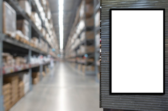 blank showcase billboard or advertising digital light box for your text message or media content with blurred image of warehouse interior with product on shelves, advertising and industrial concept