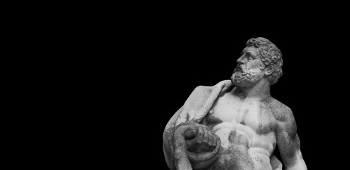 Ancient statuue of Hercules on black background Wall mural