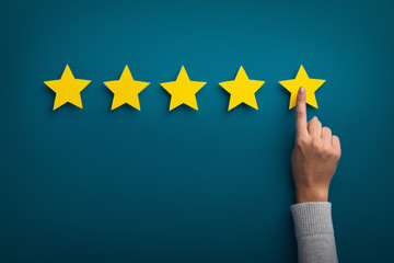 Woman hand showing on five star excellent rating