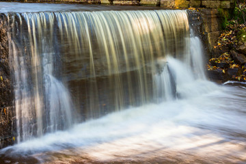 Waterfall at a mill pond