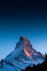 Fototapeta The famous mountain Matterhorn peak with cloudy and blue sky from Gornergrat, Zermatt, Switzerland