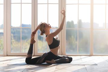 Peaceful girl practicing morning yoga at home Fotomurales