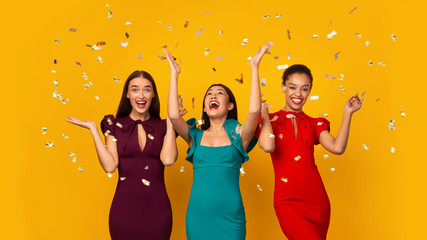 Three Multiethnic Girls In Dresses Having Fun Under Falling Confetti, Studio