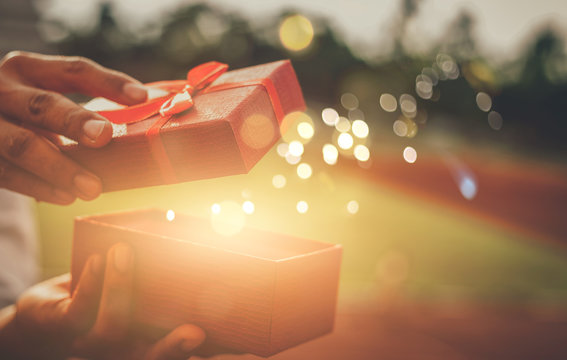 He opened a wonderful gift box for his lover.Concept merry christmas and happy new year 2020