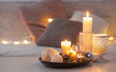 Christmas decoration   with burning candles on  white table agai