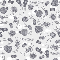 Vector seamless pattern with hats, mittens, balls of yarn and knitting needles. Background on the theme of hobby and knitting