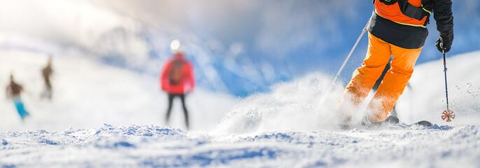 Fototapeta Winter ski sport activities in sunny day. Skier detail panorama or banner. Copy space concept. obraz