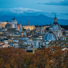 Rome skyline in the evening, as seen from Castel Sant'Angelo, with the dome of Saint Agnes Church and the Campidoglio in background.