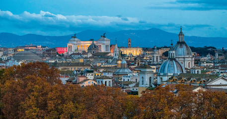Rome skyline in the evening, as seen from Castel Sant'Angelo, with the dome of Saint Agnese Church, the Campidoglio and the Altare della Patria monument.