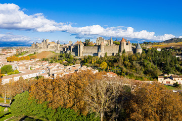 Aerial view of Cite de Carcassonne, a medieval hilltop citadel in the French city of Carcassonne, Aude, Occitanie, France. Founded in the Gallo-Roman period, the town is fortified by two castle walls