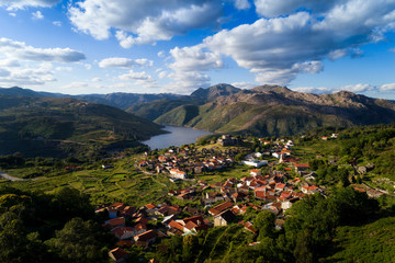 Aerial panoramic view of the historic village of Lindoso, with the surroundings mountains and lake, at the Peneda Geres National Park, in Portugal.
