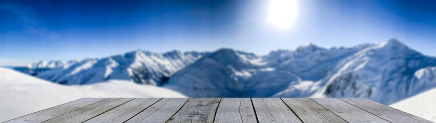 wooden shelf in front of snow mountain range