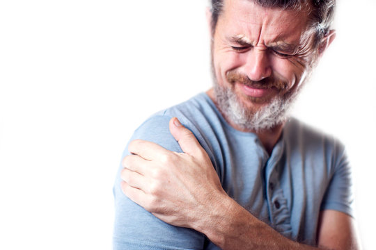 Man feels strong shoulder pain isolated. People, healthcare and medicine concept