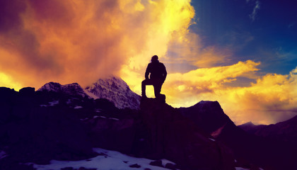 Man Kneeling On Top Of Mountain Peak Serenity Concept