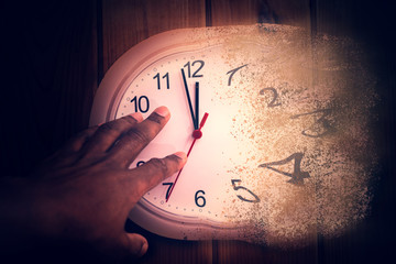 Time is running out concept shows clock that is melting away, african american man is trying to hang on to the clock