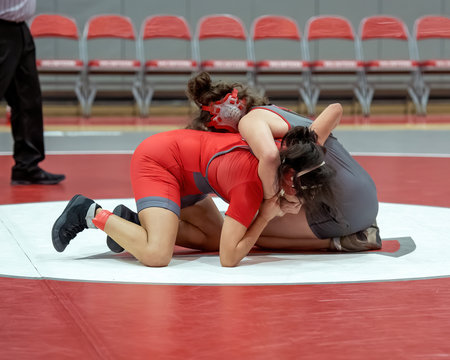 Girl High School wrestlers competing at a wrestling meet