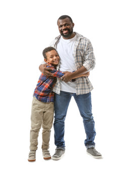 Portrait of African-American man with his little son on white background